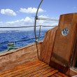 Wooden sailboat boat deck blue sky ocean sea — Zdjęcie stockowe