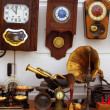 Stock Photo: Antiques fair market wall old clocks