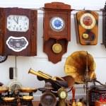Antiques fair market wall old clocks — Stock Photo