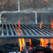 Bar b cue barbecue fire BBQ coal fire iron grill - Stock Photo