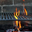 Bar b cue barbecue fire BBQ coal fire iron grill - Stockfoto