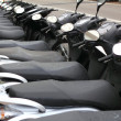 scooter mototbikes row many in rent store — Stock Photo #5506191