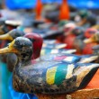 Duck decoy arrangement colorful row - Stock Photo