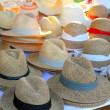Hats arrangement on market hand craft shop — Stock Photo