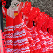 Gipsy red spots dress row typical Andalusia Spain - Stock Photo