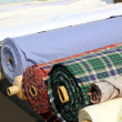 Stock Photo: Colorful fabric rolls row in market shop