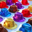 Colorful sequins hats in rows in outdoor market — Stock Photo