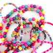 Colorful wood necklaces mess over white — Stock Photo #5506247
