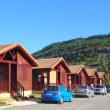 Stock Photo: Wood bungalow houses in camping area