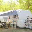 Camping camper caravtrees park bicycles — Stock Photo #5506256