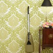 Retro vacuum cleaner vintage sixties wallpaper - Stock Photo