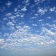 Blue sky white clouds in a summer clean day - Stock Photo