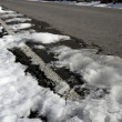 Snow on asphalt road hide white lines — Stock Photo #5507376