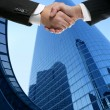 Businessman partners shaking hands with suit — Stockfoto