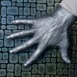 Futuristic man silver hand over textured steel — Stock Photo