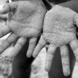 Children girl beach sand hands facing camera — Stockfoto