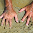 Hairy man hands on beach sand in sunny summer — Stock Photo