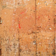 Aged grunge wooden pink orange painted door — Foto Stock