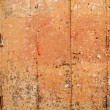 Aged grunge wooden pink orange painted door — Stock fotografie