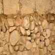 Golden masonry stone wall from old building - Stock Photo