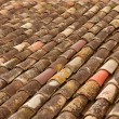 Stock Photo: Aged old clay arabic roof tiles in rows