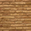 Brown brick wall in cream beige color background — Stock Photo #5507894