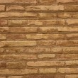 Brown brick wall in cream beige color background — Stock Photo
