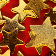 Christmas golden decoration with gold star — Stock Photo
