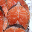Salmon fish vivid slices in a row — Stock Photo #5508223