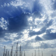 Cloudy sunset sky with sailboat mast — Stock Photo #5508310