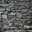 Antique grunge old gray stone wall masonry - Stock Photo