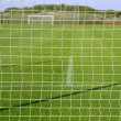 Net soccer goal football green grass field — Foto de Stock