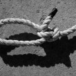 Black and white bowline gauze on marine rope - Stock Photo