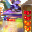 Funfair fairground attraction nigh colorful light - Stock Photo