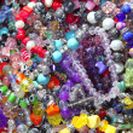 Jewellery mixed colorful many jewels plastic jewelry — Stock Photo