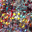 jewellery mixed colorful many jewels plastic jewelry — Stock Photo