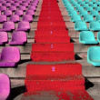 Stadium colorful grandstand stands stairway — Stock Photo