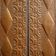 Stock Photo: Embossed brass vintage old church door detail