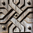 Stock Photo: Old aged wooden door iron handcraft deco