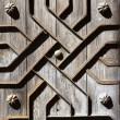 Old aged wooden door iron handcraft deco - Stock Photo