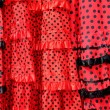 Gipsy red spots dress texture background - Stock Photo