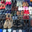 Used shoes market pattern rows second hand - Stock Photo