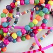 Colorful wood necklaces mess over white — Stock Photo #5508816
