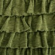 pleated skirt fabric fashion in green closeup — Stock Photo