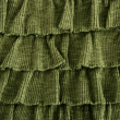 Pleated skirt fabric fashion in green closeup — Stock Photo #5508826