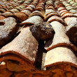 Clay roof tiles old aged arabic style in Spain - Stock Photo
