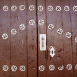 Anciend wood door with metal silver decoration — Stock Photo