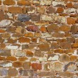 Colorful masonry wall stone construction — Stock Photo