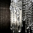 Foto Stock: Crystal strass lamp white over black background