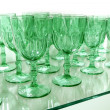 Green cups rows glass crystal kitchenware — Stock Photo